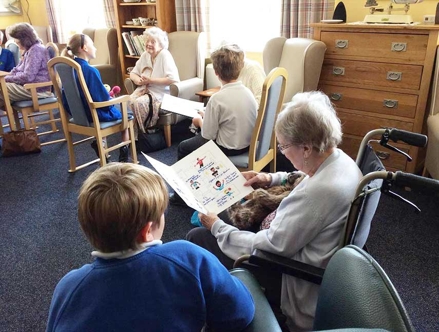Residents enjoying visit from local school children