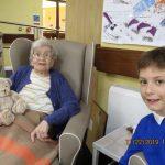 Resident enjoying visit from local school children